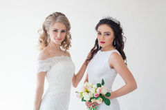 Two wedding bride with a bouquet of flowers wedding hair Stock Image