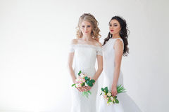 Two wedding bride with a bouquet of flowers wedding hair Royalty Free Stock Photography