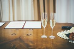 Two wedding champagne glasses on the wooden brown table stock photos