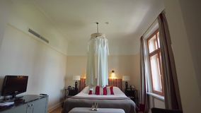 Two wedding dresses in room. Shot stock video footage