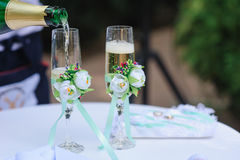 Two wedding glass pour champagne decorated with flowers Royalty Free Stock Images