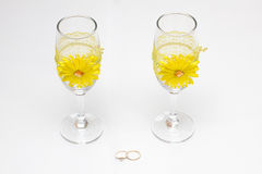 Two wedding glass and rings Stock Image