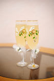 Two wedding glasses of champagne stand on the table Stock Images
