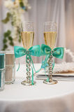 Two wedding glasses decorated with blue bows Royalty Free Stock Photos