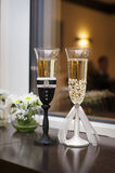 Two wedding glasses decorated in the style of the bride and groo Royalty Free Stock Photography