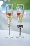Two wedding glasses of groom and bride on the tabl Stock Images