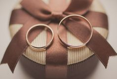 Two wedding golden rings on gift box Stock Images