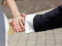 Two wedding hands. endearment people. Bride and groom Stock Photography