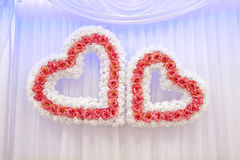 Two wedding hearts. On a fabric background Stock Photo