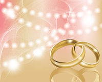 Two wedding ring with abstract background, Stock Photography