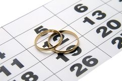 Two wedding ring on a calendar. Two wedding rings on a calendar closeup stock images