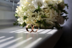 Two wedding ring near bunch Royalty Free Stock Image