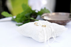 Two wedding ring on a pillow Stock Photos