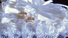 Two wedding ring on white heart. Pillow stock video footage