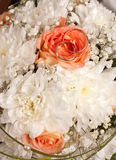 Two wedding rings. On a bouquet of roses Stock Photography