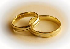 Two Wedding Rings. The lower part of the rings is in focus the upper is soft Stock Photography
