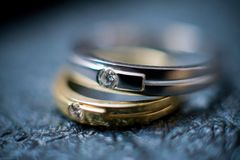 Two wedding rings. 2 wedding rings - golden and platinum ones Stock Photography