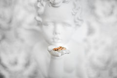Two wedding rings in angel hand Stock Photography