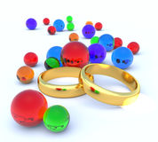 Two wedding rings and balls Royalty Free Stock Image