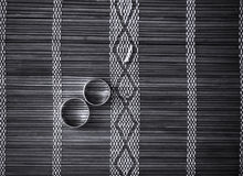 Two wedding rings on bamboo mat Royalty Free Stock Photo