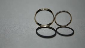 Two wedding rings. Two beautiful gold wedding rings. Wedding concept stock video
