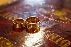 Wedding rings on bible, on church altar. Two wedding rings on bible, on church altar royalty free stock photography