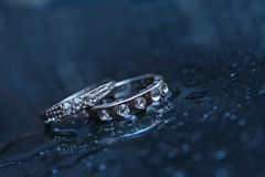 Two wedding rings on a blue background Stock Image