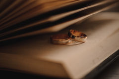 Two wedding rings on a book Royalty Free Stock Photography