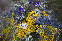 Two wedding rings on a bouquet of bright blue and yellow flowers, wedding, proposal, lifestyle-concept Royalty Free Stock Photos