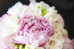 Two wedding rings. On a bouquet of flowers Stock Photography