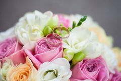Two wedding rings. On a bouquet of flowers Royalty Free Stock Images