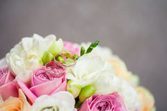 Two wedding rings. On a bouquet of flowers Stock Photo