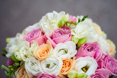 Two wedding rings. On a bouquet of flowers Royalty Free Stock Photos