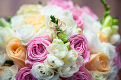 Two wedding rings. On a bouquet of flowers Royalty Free Stock Photo