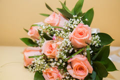 Two  wedding rings on a bouquet of pink roses. Two beautiful wedding rings on a bouquet of pink roses Stock Image