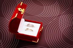 Two wedding rings in a box Stock Photos