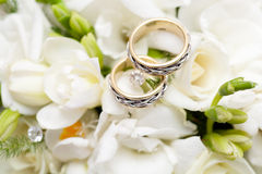 Two wedding rings on bridal bouquet Royalty Free Stock Photography