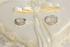 Two wedding rings on a cushion Royalty Free Stock Photography