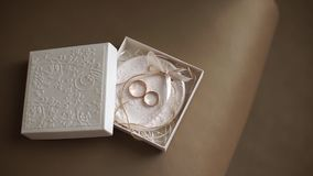 Two wedding rings in cute small white box. stock video