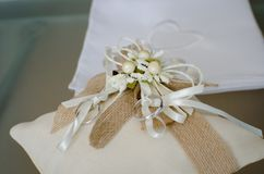 Two wedding rings on decorated pillow Stock Photography