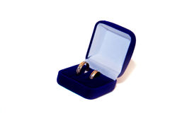 Two wedding rings in double blue box Stock Photo