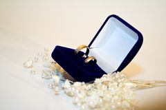 Two wedding rings in double blue box whith jewel Stock Images