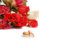 Two wedding rings and flowers