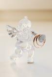 Two wedding rings on glass angel figurine. Macro Royalty Free Stock Photography
