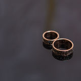 Two wedding rings in infinity sign. Love concept. Two wedding rings in infinity sign on black background. Love concept royalty free stock photo