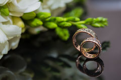 Two wedding rings in infinity sign. Love concept Stock Photography