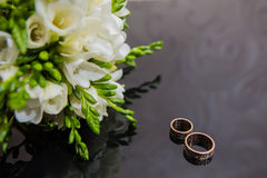 Two wedding rings in infinity sign. Love concept Stock Photos