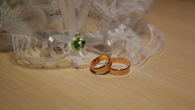 Two Wedding Rings With Lace On The Table stock video