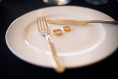 Two Wedding Rings Lie on a White Plate Stock Photography