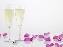 Two Wedding Rings Next To Champagne Flutes Stock Images